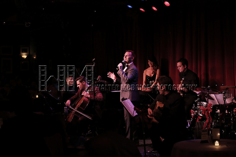 Daniel Reichard and band performing in 'Daniel Reichard's Decked Out Holiday Party' at Birdland on December 15, 2014 in New York City.