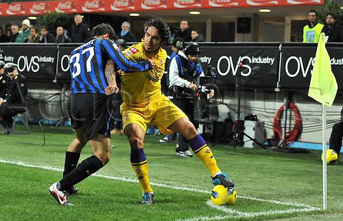 10.12.2011. Milan Italy, The Seria A football match between Inter Milan and Fiorentina. Image shows Marco Davide Faraoni Inter Juan Manuel Vargas Fiorentina Milano