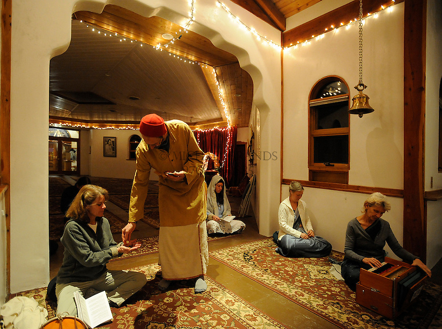 Pujari Premanand distributes food to attendees of the evening Aarati at the Haidakhandi Universal Ashram near Crestone, CO. Michael Brands for The New York Times.