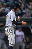 Center fielder Dom Thompson-Williams (15) of the Charleston RiverDogs claps his hands after scoring a run in Game 2 of the South Atlantic League Southern Division Playoff against the Greenville Drive on Friday, September 8, 2017, at Fluor Field at the West End in Greenville, South Carolina. Charleston won, 2-1, and the series is tied at one game each. (Tom Priddy/Four Seam Images)
