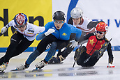01 February 2019, Saxony, Dresden: Shorttrack: World Cup, quarter finals, 1500 meter men in the EnergieVerbund Arena. Jialong Tian (r) from China crashes in a curve.