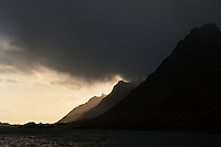 Steep mountains rise from sea; Lofoten islands; Norway