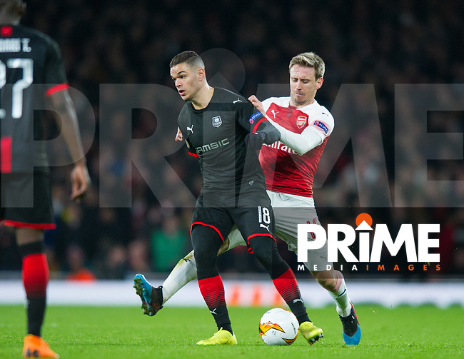 Rennes Hatem Ben Arfa and Arsenal's Nacho Monreal during the UEFA Europa League match between Arsenal and Rennes at the Emirates Stadium, London, England on 14 March 2019. Photo by Andrew Aleksiejczuk / PRiME Media Images.