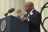 Civil rights leader and Democratic Representative from Georgia John Lewis delivers remarks in front of a freedom bell during the 'Let Freedom Ring' commemoration event, at the Lincoln Memorial in Washington DC, USA, 28 August 2013. The event was held to commemorate the 50th anniversary of the 28 August 1963 March on Washington led by the late Dr. Martin Luther King Jr., where he famously gave his 'I Have a Dream' speech.<br /> Credit: Michael Reynolds / Pool via CNP