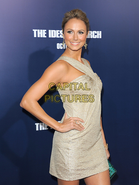 Stacy Keibler.The L.A. Premiere of 'The Ides of March' held at The Academy of Motion Picture Arts & Sciences  in Beverly Hills, California, USA..September 27th, 2011.half length dress side hand on hip beige silver gold smiling  .CAP/RKE/DVS.©DVS/RockinExposures/Capital Pictures.
