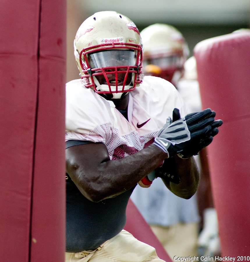 TALLAHASSEE, FL 8/27/10 -FSU-082710  CH-Florida State's Anthony McCloud blasts through the pylons during practice Friday in Tallahassee. .COLIN HACKLEY PHOTO