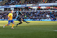 Jerell Sellars of Wycombe Wanderers (right) shoots during the Sky Bet League 2 match between Wycombe Wanderers and Mansfield Town at Adams Park, High Wycombe, England on 25 March 2016. Photo by David Horn.