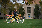 October 24, 2016; Student walks her bike on North Quad (Photo by Matt Cashore/University of Notre Dame)