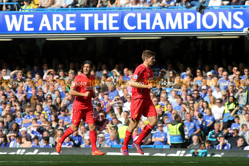 Liverpool's Steven Gerrard celebrates his goal with a clenched fist as he runs back to the halfway line - Chelsea vs Liverpool - Barclays Premier League Football at Stamford Bridge, London - 10/05/15 - MANDATORY CREDIT: Paul Dennis/TGSPHOTO - Self billing applies where appropriate - contact@tgsphoto.co.uk - NO UNPAID USE