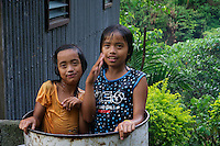 Girls having a bath in a drum, Banaue Mountain Province Rice Terraces Philippines