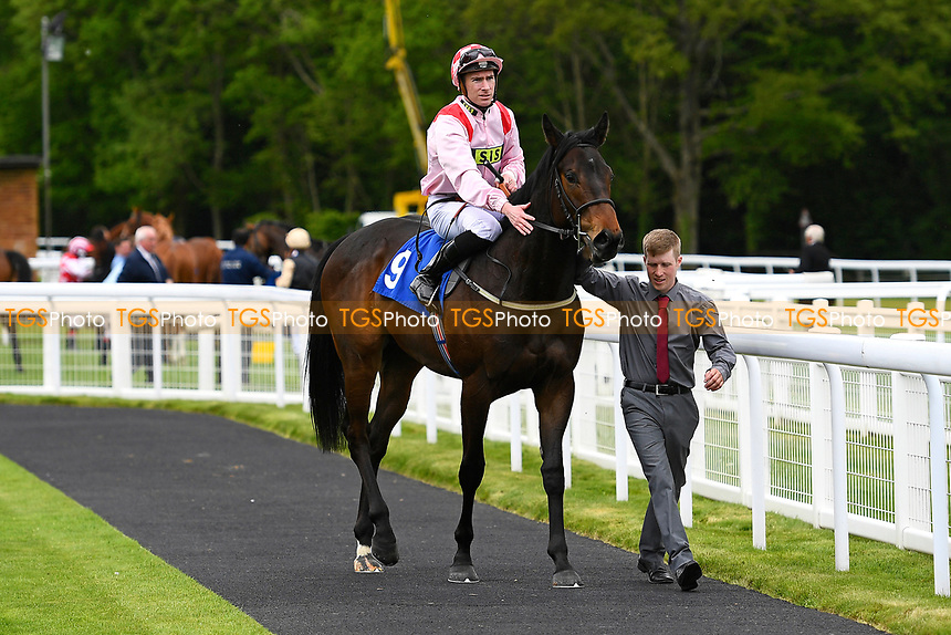 Winner of The Simon & Nerys Dutfield Memorial Novice Stakes,Youkan ridden by Martin Lane and trained by Stuart Kittow enter the winners enclosure during Afternoon Racing at Salisbury Racecourse on 18th May 2017