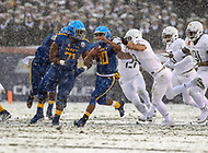 Philadelphia, PA - December 9, 2017:   Navy Midshipmen running back Malcolm Perry (10) aviods a tackle during the 118th game between Army vs Navy at Lincoln Financial Field in Philadelphia, PA. (Photo by Elliott Brown/Media Images International)