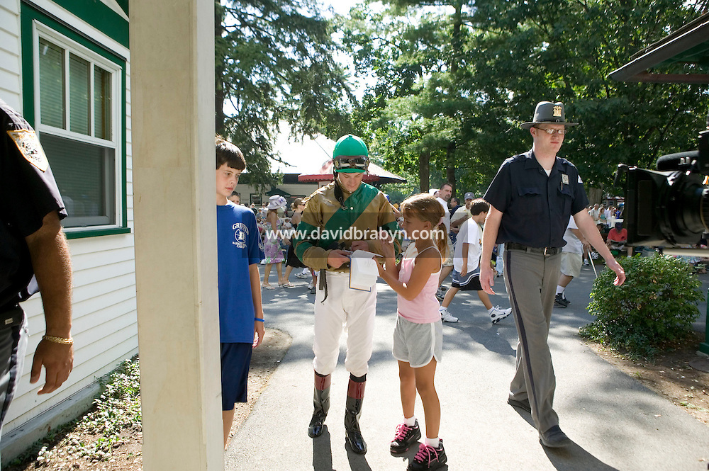 Jockey Julien Leparoux (C) signs an autograph for a child after a race in Saratoga Springs, NY, United States, 5 August 2006.