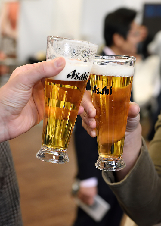 Toasting glasses at a marketing event for Asahi Beer.