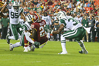 Landover, MD - August 16, 2018: Washington Redskins running back Rob Kelley (20) is tackled by New York Jets linebacker Darron Lee (58) during the preseason game between New York Jets and Washington Redskins at FedEx Field in Landover, MD.   (Photo by Elliott Brown/Media Images International)