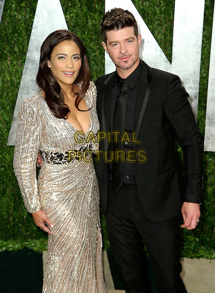 Paula Patton & Robin Thicke.2013 Vanity Fair Oscar Party following the 85th Academy Awards held at the Sunset Tower Hotel, West Hollywood, California, USA..February 24th, 2013.oscars half length silver gold metallic dress plunging neckline cleavage belt black suit married husband wife stubble facial hair  .CAP/ADM/SLP/DOW.©Dowling/StarlitePics/AdMedia/Capital Pictures