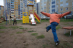 Children play soccer near a center for drug dealing in Kazan, Russia, on Saturday, September 22, 2007.