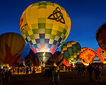 A near record crowd hot air balloon fans filled the hillsides at the National Balloon Classic launch field July 30 for a fly-in and Night Glow.