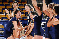 13 September 2008:  FIU middle blocker Sabrina Gonzalez (12) high-fives with her teammates during player introductions prior to the FIU 3-0 (25-11, 25-19, 25-19) victory over Penn in the 2008 FIU Invitational tournament at Panther Arena in Miami, Florida.