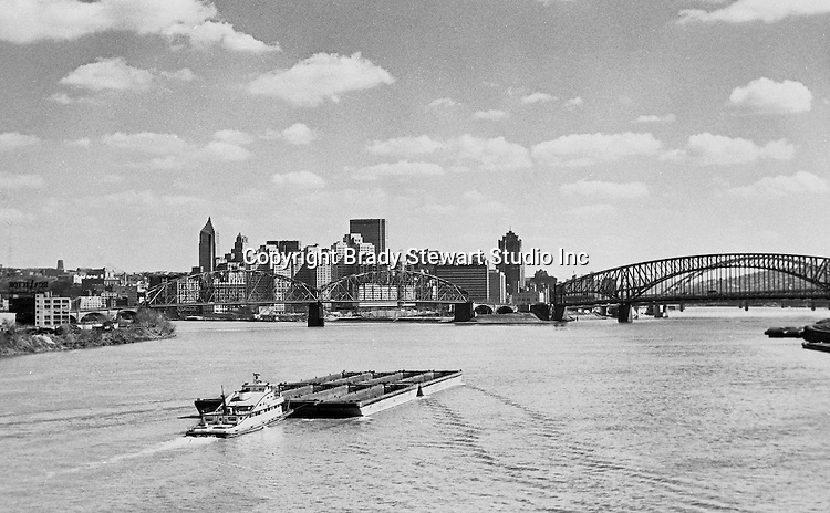 Pittsburgh PA:  Looking up the Ohio River toward the Point from the West End Bridge - 1959.  Pittsburgh Hilton is under construction.