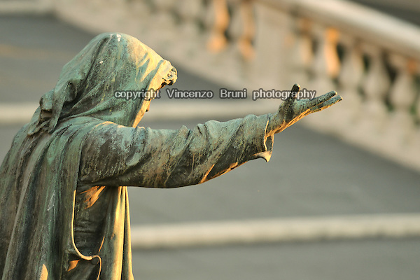 "Rome, Italy: Bronze statue 'La Clemenza' (""The Mercy"") along the steps leading to Piazza del Campidoglio"