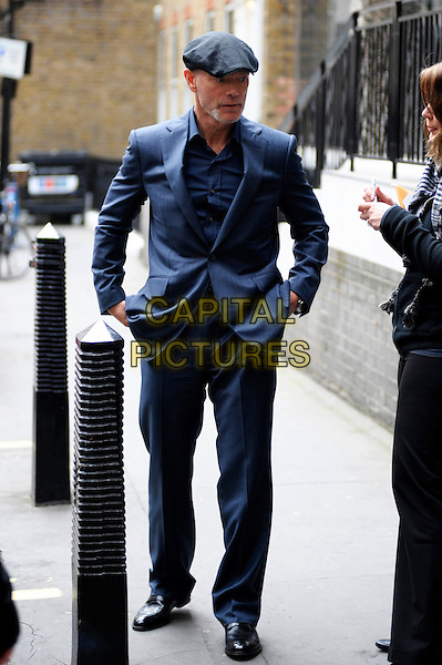 STEPHEN LANG.At the BBC, London, England..April 26th, 2010.full length blue suit flat cap hat goatee facial hair hands in pockets  .CAP/DYL.©Dylan/Capital Pictures.