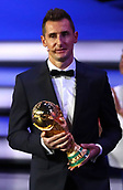 1st December 2017, State Kremlin Palace, Moscow, Russia;  World Cup record goal-scorer Miroslav Klose from Germany holds the World Cup trophy onstage as the representative of the current world champion during the FIFA 2018 World Cup draw, at the State Kremlin Palace in Moscow, Russia, 01 December 2017.