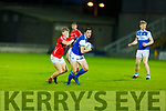 Evan Cronin of East Kerry putting the shackles on David Morans of Kerins O'Rahillys attempt to get forward in the County Football Championship 3rd round game on Saturday.