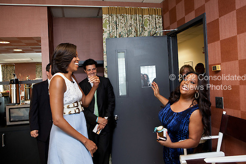 """First Lady Michelle Obama greets Sherri Shepherd of """"The View"""" at the show's studio in New York, New York, May 29, 2012. .Mandatory Credit: Sonya N. Hebert - White House via CNP"""