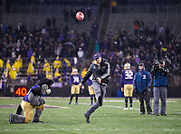 UW student Micah Pigott nails a halftime kick for $1000.