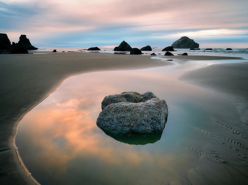 Low tide pool and sunset. Bandon, Oregon.