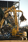 Recycled metal being shredded for export