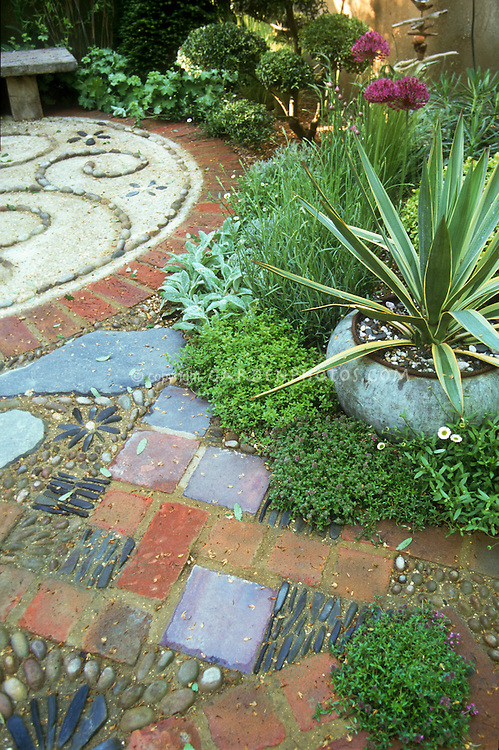 artist s garden with round patio and cacti succulent plant in pot