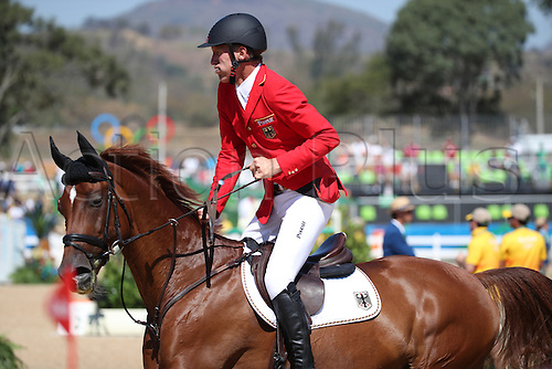 14.08.2016. Rio de Janeiro, Brazil. Ludger Beerbaum of Germany rides his horse Casello during the Jumping Team 1st Qualifier of the Equestrian competition at the Olympic Equestrian Centre during the Rio 2016 Olympic Games in Rio de Janeiro, Brazil, 14 August 2016.
