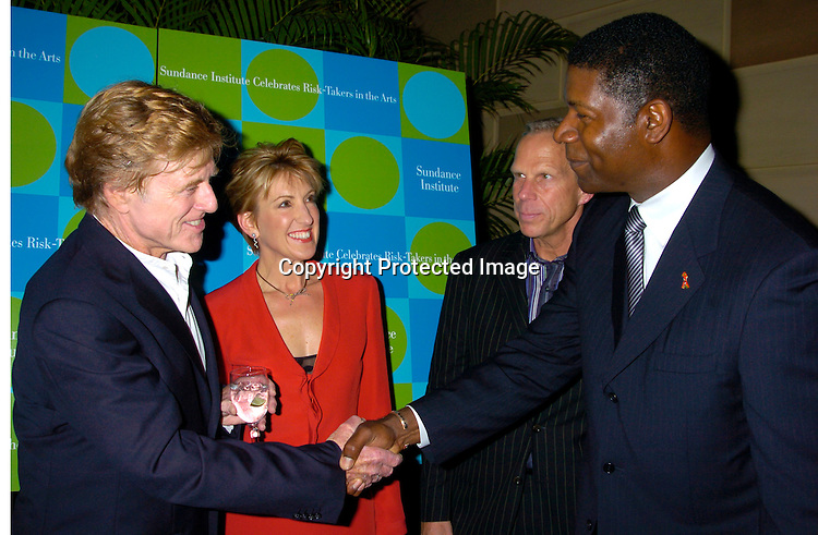 Robert Redford, Carly Fiorina  Steve Tisch and Dennis Haysbert ..at the Third Annual Sundance Institute Gala honoring ..Risk-Takers in the Arts on April 22, 2004 at Gotham Hall. ..Photo by Robin Platzer, Twin Images
