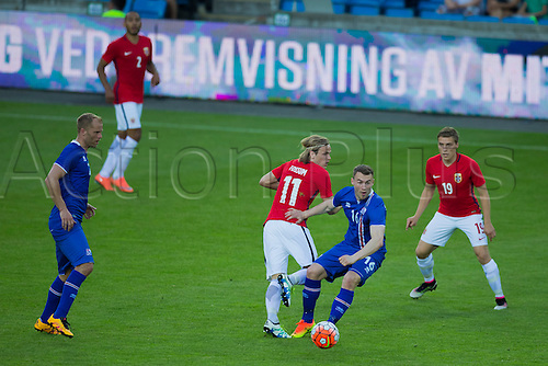 01.06.2016  Ullevaal Stadion, Oslo, Norway. (C)   Runar Mar Sigurjonsson of Iceland  takes the ball away from Norways Fossum during the International Football Friendly match between Norway versus Iceland at  Ullevaal Stadion in Oslo, Norway.