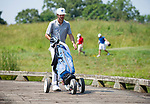 MUSCLE SHOALS, AL - MAY 25: Lynn's Manuel Torres crosses the bridge to the No. 9 tee box during the Division II Men's Team Match Play Golf Championship held at the Robert Trent Jones Golf Trail at the Shoals, Fighting Joe Course on May 25, 2018 in Muscle Shoals, Alabama. Lynn defeated West Florida 3-2 to win the national title. (Photo by Cliff Williams/NCAA Photos via Getty Images)