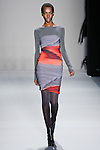 Herieth Paul walks the runway in a Nicole Miller Fall 2011 outfit, during Mercedes-Benz Fashion Week.