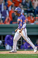 Second baseman Jordan Greene (9) of the Clemson Tigers shouts after scoring a run in the Reedy River Rivalry game against the South Carolina Gamecocks on Saturday, March 2, 2019, at Fluor Field at the West End in Greenville, South Carolina. Clemson won, 11-5. (Tom Priddy/Four Seam Images)