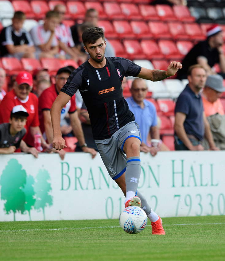 Lincoln City's Ellis Chapman during the pre-match warm-up<br /> <br /> Photographer Chris Vaughan/CameraSport<br /> <br /> Football Pre-Season Friendly - Lincoln City v Stoke City - Wednesday July 24th 2019 - Sincil Bank - Lincoln<br /> <br /> World Copyright © 2019 CameraSport. All rights reserved. 43 Linden Ave. Countesthorpe. Leicester. England. LE8 5PG - Tel: +44 (0) 116 277 4147 - admin@camerasport.com - www.camerasport.com