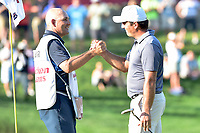 Bethesda, MD - July 1, 2018: Francesco Molinari and his Caddy share a moment after Francesco wins Quicken Loans National in record fashion at TPC Potomac at Avenel Farm in Bethesda, MD.  (Photo by Phillip Peters/Media Images International)