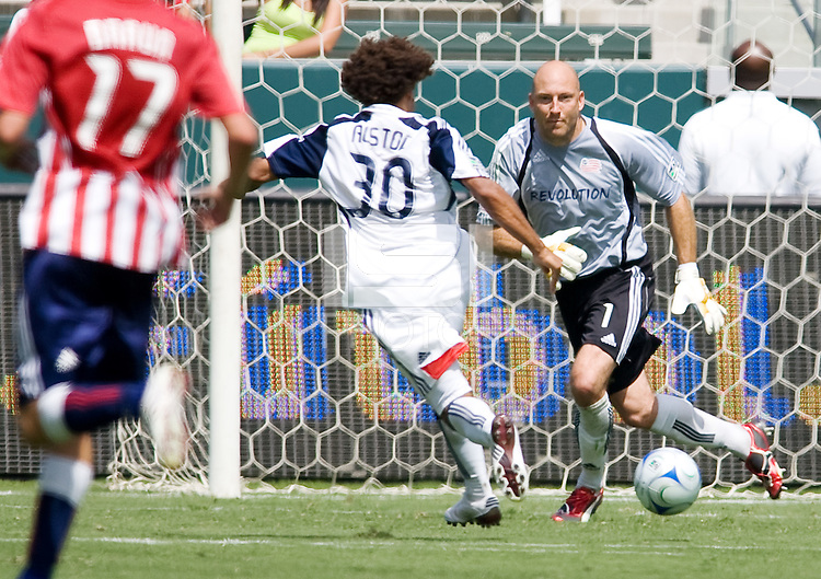 New England Revolution midfielder Kevin Alston and teammate goalkeeper Matt Reis move to the ball. Chivas USA defeated the New England Revolution 2-0 at Home Depot Center stadium in Carson, California on Sunday September 13, 2009...