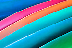 Colorful abstract of canoes on the beach