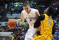 February 7, 2015 - Colorado Springs, Colorado, U.S. -  Air Force forward, Marek Olesinski #0, drives for a layup during an NCAA basketball game between the University of Wyoming Cowboys and the Air Force Academy Falcons at Clune Arena, U.S. Air Force Academy, Colorado Springs, Colorado.  Air Force soars to a 73-50 win over Wyoming.