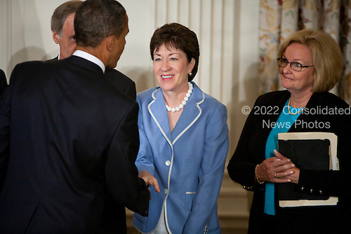 United States President Barack Obama shakes hands with U.S. Senator Susan Collins (Republican of Maine) after signing the Improper Payments Elimination and Recovery Act at the White House in Washington, D.C., U.S., on Thursday, July 22, 2010. .Credit: Brendan Hoffman / Pool via CNP