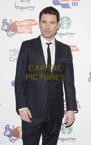 DAVE BERRY.The Capital FM Summertime Ball, Wembley Stadium, London, England..June 12th, 2011.half length black pinstripe suit tie white shirt.CAP/CAN.©Can Nguyen/Capital Pictures.