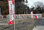March 10, 2012, Minamisannriku-cho, Japan - Banners flatter in the early spring breeze at a temporary shopping mall recently completed in the empty lot of Minamisannriku-cho, Miyagi Prefecture, some 365 km northeast of Tokyo, on Saturday, March 10, 2012. ..One year after the strongest earthquake ever to hit Japan, the economy is recovering and massive cleanup operations are in full swing throughout much of the countrys northeastern region. But once-pastoral landscapes that were piled with rubble and debris have become empty wastelands due mainly to bickering and disagreements between the central and local governments over rebuilding the devastated region. A year later, more than 260,000 people still live in temporary shelters. (Photo by Natsuki Sakai/AFLO) AYF -mis-.