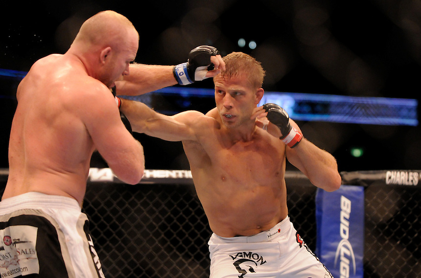 24 SEPTEMBER 2011:  Tim Boetsch throws a punch against Nick Ring   during UFC 135 at the Pepsi Center in Denver, Colorado. *****For Editorial Use Only*****