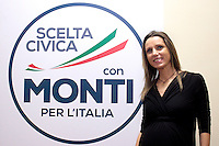 Valentina Vezzali incinta accando al simbolo.Roma 15/02/2013 Presentazione del programma per lo sport della Scelta Civica Monti per l'Italia..The italian premier presents his program for sport for the next elections 2013 and candidate two of the best athlets in the world at the past olympic and paralympic games. .Photo Samantha Zucchi Insidefoto