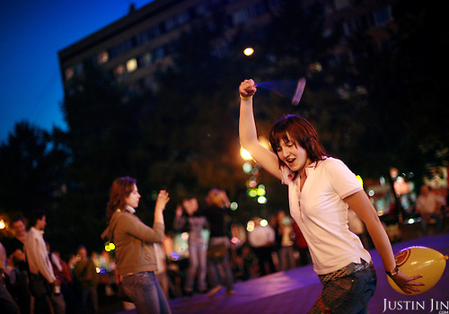 Young people dance at the Pushkin Square (Pushkinskaya Plochad) in the heart of Moscow on a fine summer's night. .The square is marked for a major revamp that will irk those who accuse the government of tearing down historic parts of the Russian capital. .Pushkin is one of Russia's most important writer.